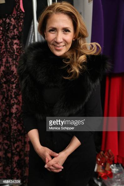 Designer Reem Acra prepares backstage at the Reem Acra fashion show during MercedesBenz Fashion Week Fall 2014 at The Salon at Lincoln Center on...