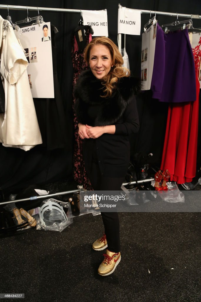 Designer <a gi-track='captionPersonalityLinkClicked' href=/galleries/search?phrase=Reem+Acra+-+Fashion+Designer&family=editorial&specificpeople=8798513 ng-click='$event.stopPropagation()'>Reem Acra</a> prepares backstage at the <a gi-track='captionPersonalityLinkClicked' href=/galleries/search?phrase=Reem+Acra+-+Fashion+Designer&family=editorial&specificpeople=8798513 ng-click='$event.stopPropagation()'>Reem Acra</a> fashion show during Mercedes-Benz Fashion Week Fall 2014 at The Salon at Lincoln Center on February 10, 2014 in New York City.