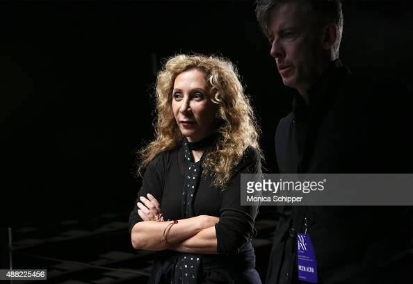 Designer Reem Acra speaks with press backstage at Reem Acra Spring 2016 during New York Fashion Week The Shows at The Dock Skylight at Moynihan...