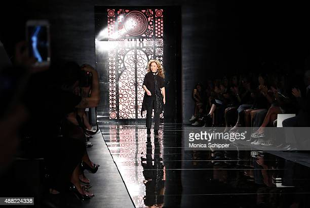 Designer Reem Acra walks the runway at Reem Acra Spring 2016 during New York Fashion Week The Shows at The Dock Skylight at Moynihan Station on...