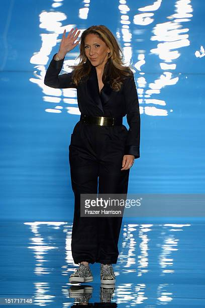 Designer Reem Acra walks the runway at the Reem Acra Spring 2013 fashion show during MercedesBenz Fashion Week at The Stage at Lincoln Center on...