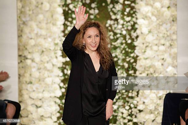 Designer Reem Acra walks the runway during the Reem Acra Fall 2015 Bridal Collection show on October 10 2014 in New York City