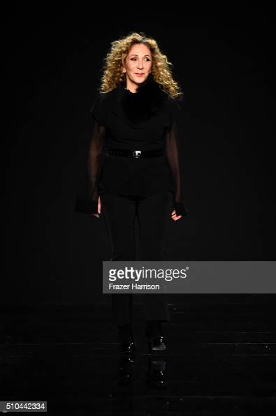 Designer Reem Acra walks the runway wearing Reem Acra Fall 2016 during New York Fashion Week The Shows at The Dock Skylight at Moynihan Station on...