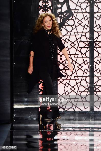 Designer Reem Acra walks the runway wearing Reem Acra Spring 2016 during New York Fashion Week The Shows at The Dock Skylight at Moynihan Station on...