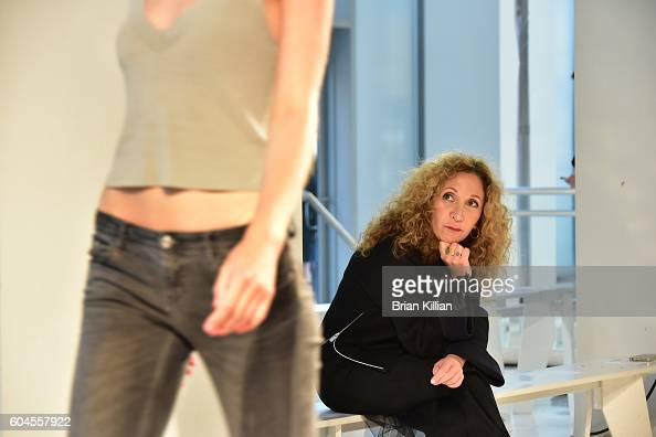 Designer Reem Acra watches her models during rehearsal just before the start of the Reem Acra show during September 2016 New York Fashion Week Show...