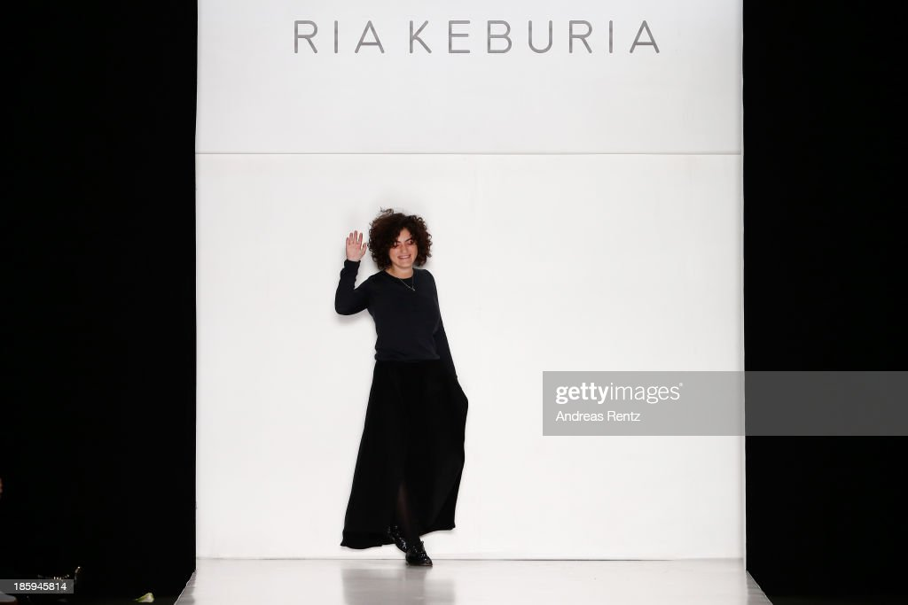 Designer Ria Keburia appears on the runway at the end of the RIA KEBURIA show during Mercedes-Benz Fashion Week Russia S/S 2014on October 26, 2013 in Moscow, Russia.