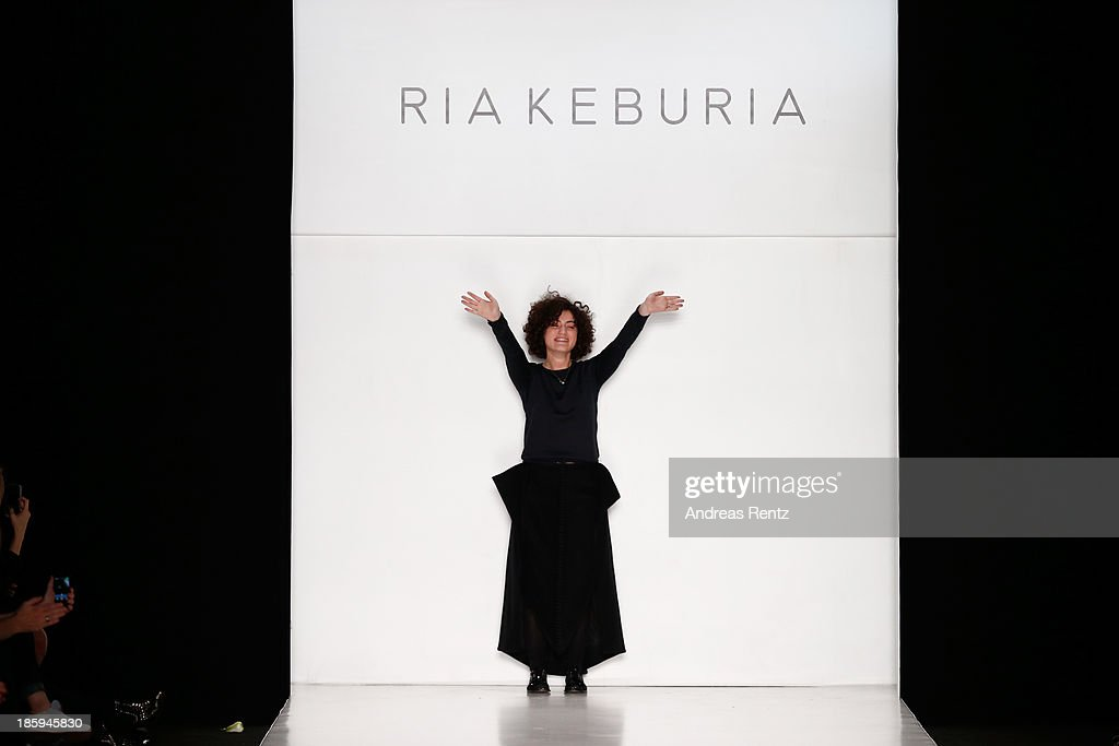 Designer Ria Keburia appears on the runway at the RIA KEBURIA show during Mercedes-Benz Fashion Week Russia S/S 2014on October 26, 2013 in Moscow, Russia.