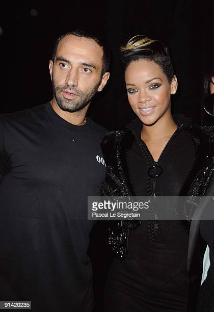 Designer Ricardo Tisci and Rihanna pose backstage during the Givenchy Pret a Porter show as part of the Paris Womenswear Fashion Week Spring/Summer...