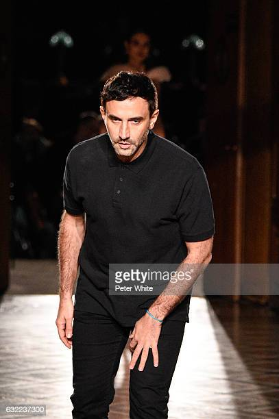 Designer Riccardo Tisci acknowledges the applause of the audience after the Givenchy Menswear Fall/Winter 20172018 show as part of Paris Fashion Week...