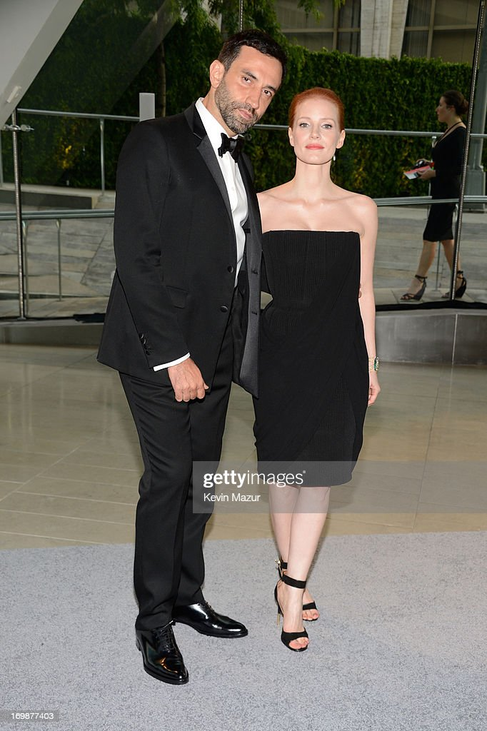 Designer <a gi-track='captionPersonalityLinkClicked' href=/galleries/search?phrase=Riccardo+Tisci&family=editorial&specificpeople=2214975 ng-click='$event.stopPropagation()'>Riccardo Tisci</a> (L) and actress <a gi-track='captionPersonalityLinkClicked' href=/galleries/search?phrase=Jessica+Chastain&family=editorial&specificpeople=653192 ng-click='$event.stopPropagation()'>Jessica Chastain</a> attend 2013 CFDA Fashion Awards at Alice Tully Hall on June 3, 2013 in New York City.