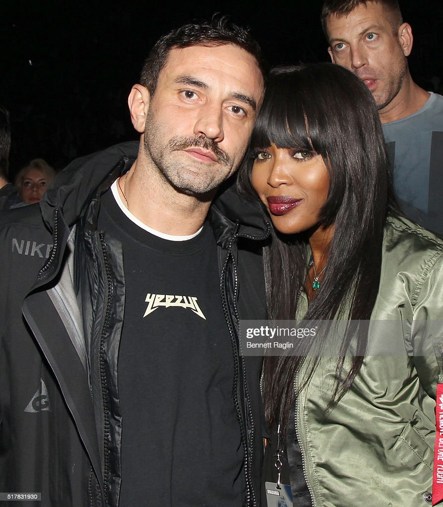 Designer Riccardo Tisci and Naomi Campbell attend the D'USSE VIP Riser At Rihanna: ANTI World Tour at Barclays Center on March 27, 2016 in New York City.