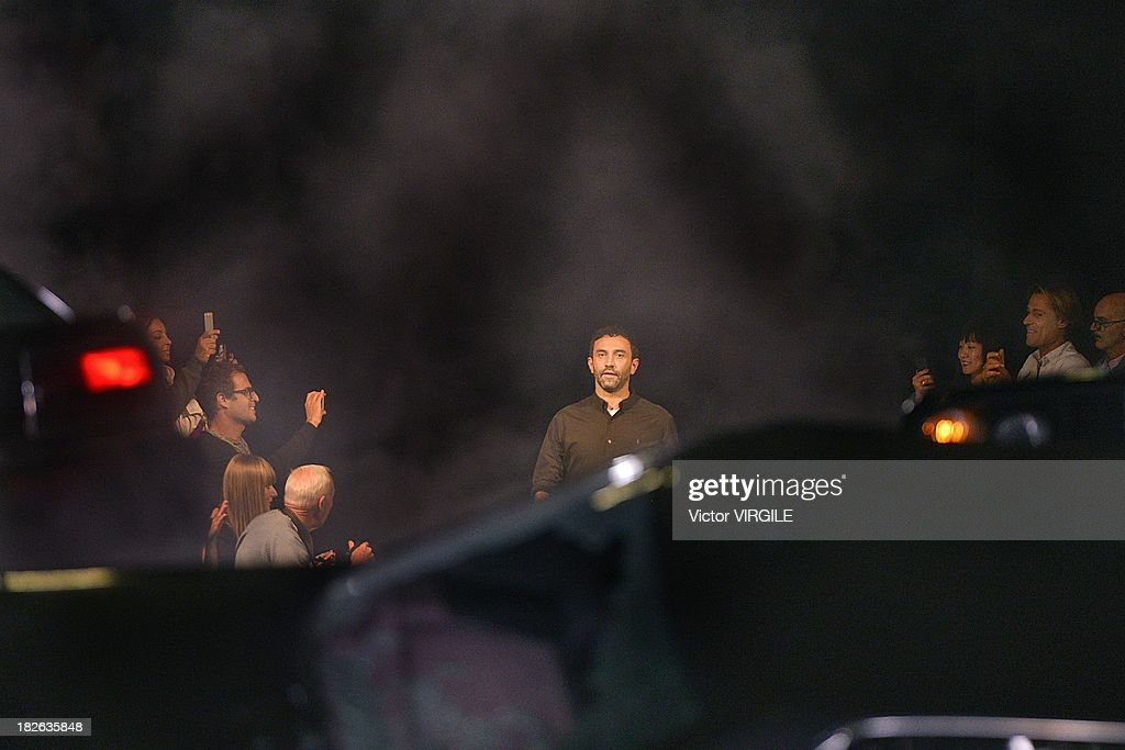 Designer Riccardo Tisci walks the runway during the Givenchy Ready to Wear show as part of the Paris Fashion Week Womenswear Spring/Summer 2014 held at 'la Halle Freyssinet' on September 29, 2013 in Paris, France.