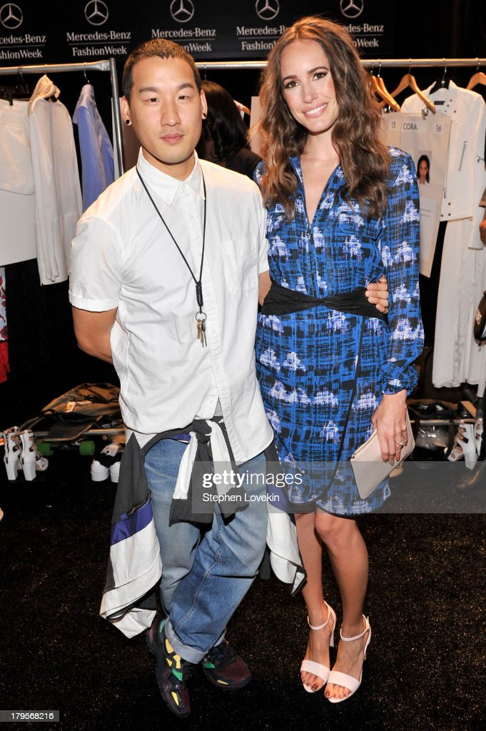 Designer Richard Chai (L) and television personality Louise Roe pose backstage at the Richard Chai Spring 2014 fashion show during Mercedes-Benz Fashion Week at The Stage at Lincoln Center on September 5, 2013 in New York City.