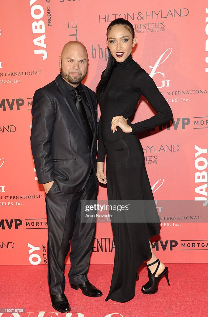 Designer Richard Hallmarq and his muse, model <a gi-track='captionPersonalityLinkClicked' href=/galleries/search?phrase=Naima+Mora&family=editorial&specificpeople=601257 ng-click='$event.stopPropagation()'>Naima Mora</a>, arrive at the 5th Annual Designer & The Muse Hosted By Kathy Hilton at Mr. C Beverly Hills on October 23, 2013 in Beverly Hills, California.