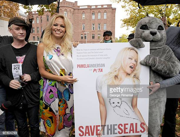 Designer Richie Rich and Pamela Anderson appear with a person dressed as a baby seal to unveil a new PETA campaign at the Ontario Legislative...