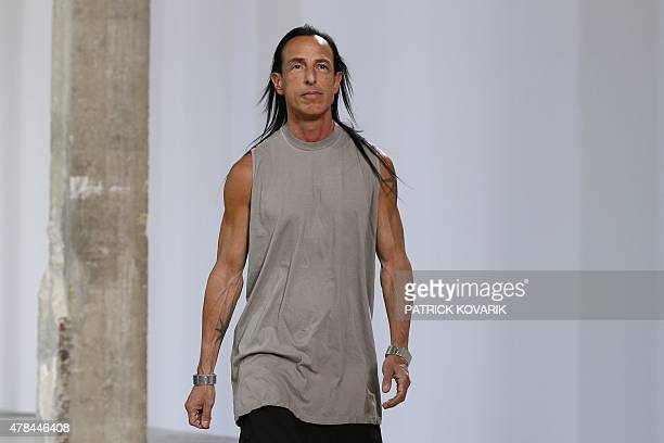 US designer Rick Owens is pictured at the end of his men's Spring Summer collection fashion show in Paris on June 25 2015 AFP PHOTO / PATRICK KOVARIK