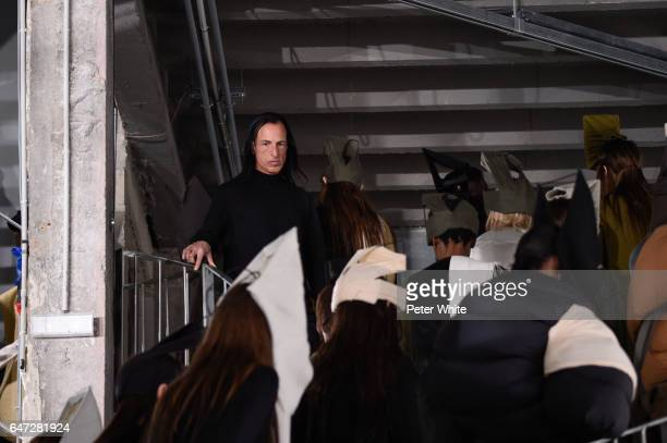 Designer Rick Owens walks the runway after the Rick Owens show as part of the Paris Fashion Week Womenswear Fall/Winter 2017/2018 on March 2 2017 in...