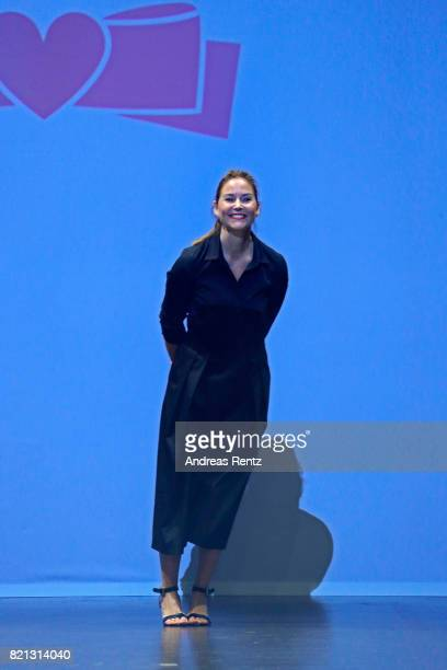 Designer Rieke Common acknowledges the applause of the audience after the 'Maison Common' show at the PF Selected show during Platform Fashion July...