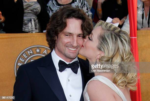 Designer Robert Godley and actress Jane Krakowski arrive at the 16th Annual Screen Actors Guild Awards held at the Shrine Auditorium on January 23...