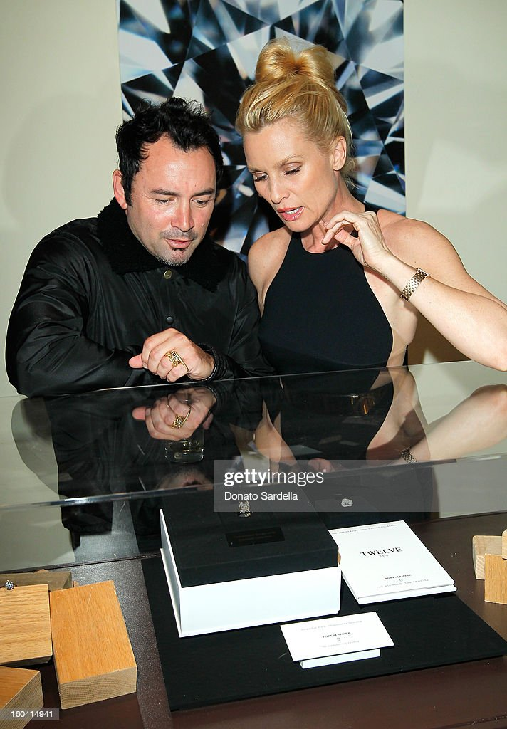 Designer Robert Keith of Hoorsenbuh and Nicollette Sheridan attend Hoorsenbuhs for Forevermark Collection cocktail party at Chateau Marmont on January 30, 2013 in Los Angeles, California.