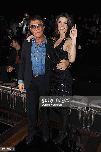 Designer Roberto Cavalli and Elisabetta Canalis attends Roberto Cavalli Milan Fashion Week Autumn/Winter 2010 show on February 28 2010 in Milan Italy