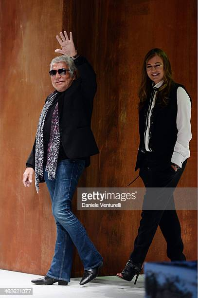 Designer Roberto Cavalli and Eva Cavalli acknowledges the applause of the public after the Roberto Cavalli show as a part of Milan Fashion Week...