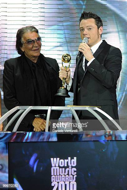 Designer Roberto Cavalli and Tiziano Ferro speak onstage during the World Music Awards 2010 at the Sporting Club on May 18 2010 in Monte Carlo Monaco