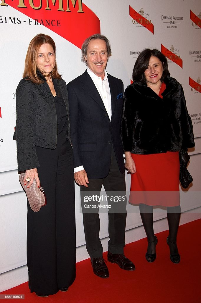 Designer <a gi-track='captionPersonalityLinkClicked' href=/galleries/search?phrase=Roberto+Torretta+-+Fashion+Designer&family=editorial&specificpeople=13914135 ng-click='$event.stopPropagation()'>Roberto Torretta</a> (C) attends the Maison Mumm inauguration at the Santo Mauro Hotel on December 11, 2012 in Madrid, Spain.