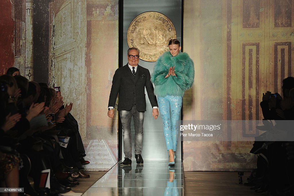 Designer Rocco Barocco acknowledges the applause of the audience after the Roccobarocco show as part of Milan Fashion Week Womenswear Autumn/Winter 2014 on February 23, 2014 in Milan, Italy.