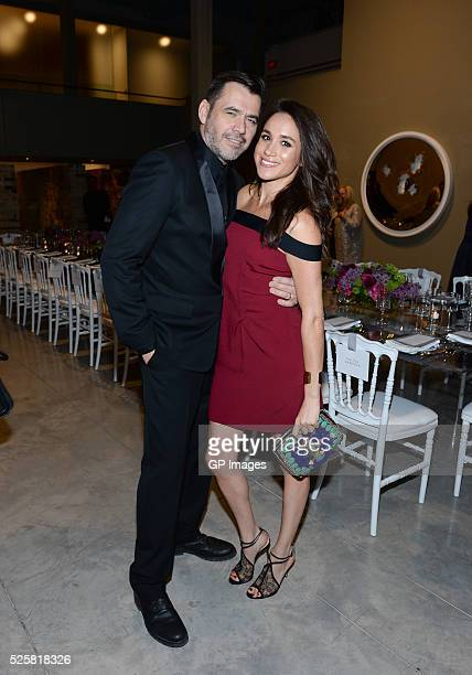 Designer Roland Mouret and actress Meghan Markle attend the Roland Mouret private dinner at Corkin Gallery on April 28 2016 in Toronto Canada