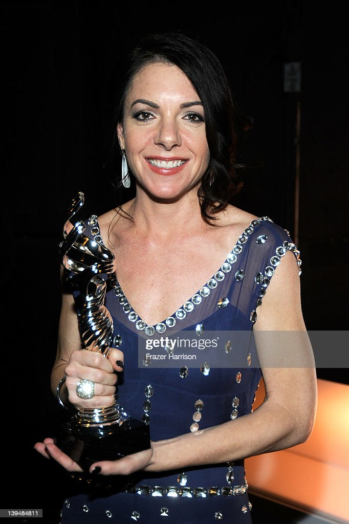 Designer Roseanne Fiedler poses with the Outstanding Commercial Costume Design Award during the 14th Annual Costume Designers Guild Awards With Presenting Sponsor Lacoste held at The Beverly Hilton hotel on February 21, 2012 in Beverly Hills, California.