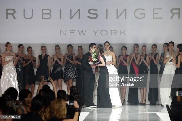 Designer Rubin Singer receives a bouquet of flowers at the end of his show during the Audi Red Carpet Night at Tent at Orchard on May 13 2014 in...