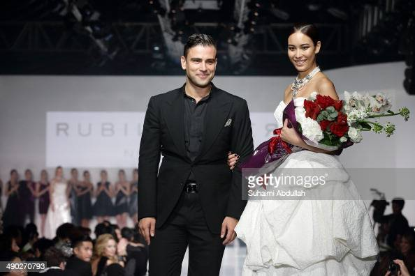 Designer Rubin Singer takes to the runway at the end of his show during the Audi Red Carpet Night at Tent at Orchard on May 13 2014 in Singapore