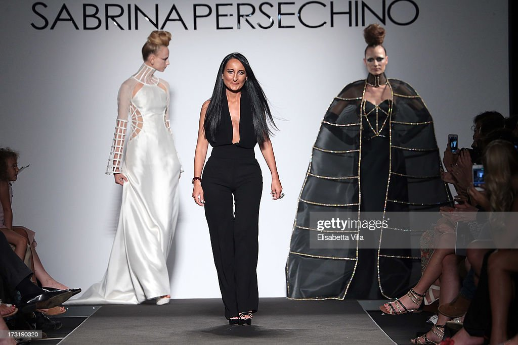 Designer Sabrina Persechino acknowledges the public after her F/W 2013-2014 Haute Couture collection fashion show as part of AltaRoma AltaModa Fashion Week at Santo Spirito In Sassia on July 9, 2013 in Rome, Italy.