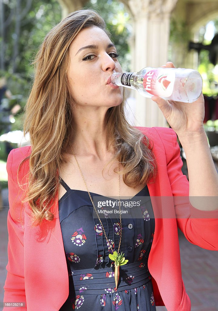 Designer Samantha Lockwood enjoys refreshment from Hint at Posing Heroes, 'A Dog Day Afternoon' Benefiting A Wish For Animals on March 30, 2013 in Los Angeles, California.