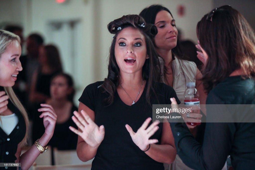 Designer Sammi Giancola watches rehearsals at Sammi Sweetheart Spring 2013 at the Metropolitan Pavilion on September 10 2012 in New York City