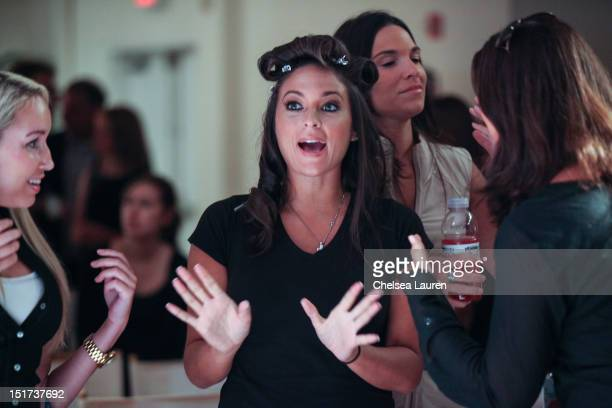 Designer Sammi Giancola watches rehearsals at Sammi Sweetheart Spring 2013 at the Metropolitan Pavilion on September 10 2012 in New York City