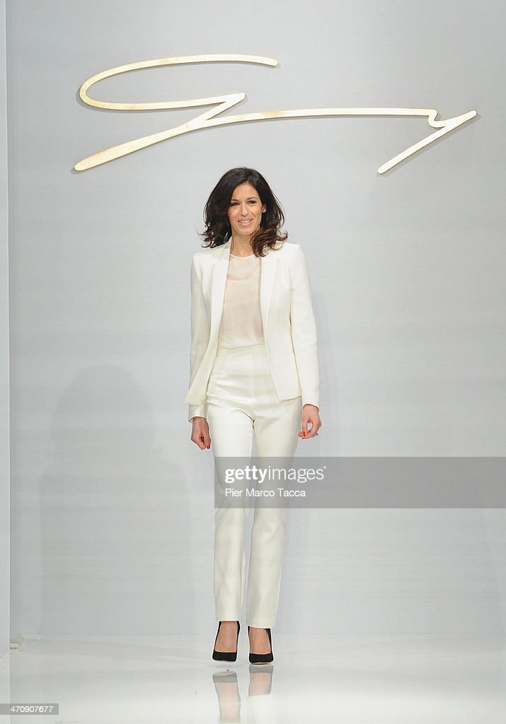 Designer Sara Cavazza Facchini acknowledges the applause of the audience during the Genny Show as part of Milan Fashion Week Womenswear Autumn/Winter 2014 on February 21, 2014 in Milan, Italy.