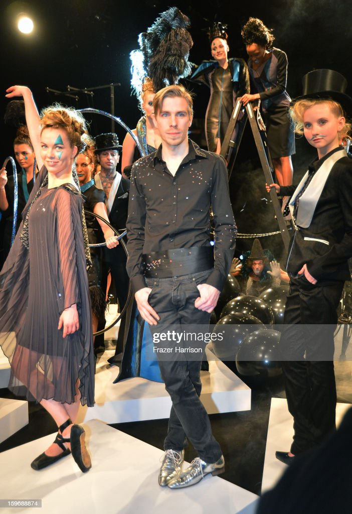 Designer Sebastian Ellrich (M) and models pose at the Sebastian Ellrich Autumn/Winter 2013/14 fashion show during Mercedes-Benz Fashion Week Berlin at Brandenburg Gate on January 18, 2013 in Berlin, Germany.