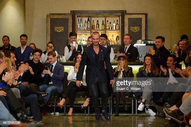 Designer Serdar Uzuntas attend his show during Mercedes Benz Fashion Week Istanbul FW15 on March 20 2015 in Istanbul Turkey