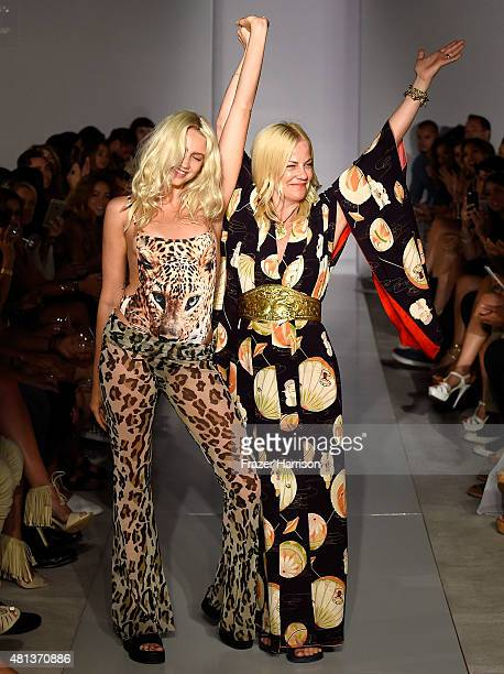 Designer Sharleen Ernster walks the runway at the HotAsHell fashion show during SWIMMIAMI at 1 Hotel South Beach Salon on July 19 2015 in Miami Beach...
