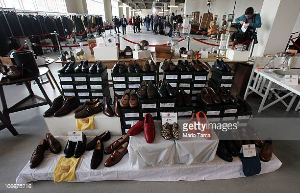 Designer shoes are displayed at a press preview of an auction of 400 pieces of personal property jewelry and antiques from Bernard and Ruth Madoff...