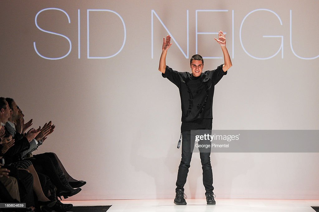 Designer Sid Neigum presents his spring 2014 collection during World MasterCard Fashion Week Spring 2014 at David Pecaut Square on October 22, 2013 in Toronto, Canada.