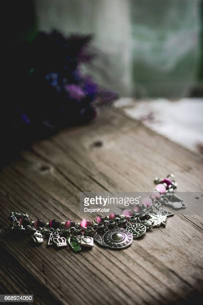Designer Silver Necklace on wooden table