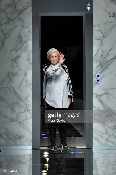 Designer Silvia Venturini Fendi acknowledges the applause of the audience after the Fendi show during Milan Men's Fashion Week Spring/Summer 2018 on...