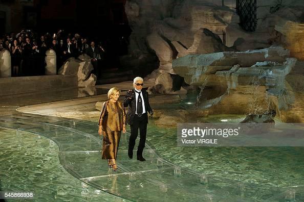 Designer Silvia Venturini Fendi and designer Karl Lagerfeld walk the runway at the Fendi Roma 90 Years Anniversary fashion show at the Fontana di...