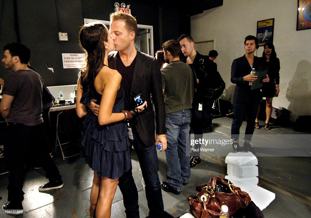 Designer Simon Spurr kisses his wife Justine Kahn as theyattends the Simon Spurr Spring 2011 fashion show during Mercedes-Benz Fashion Week at Exit Art on September 12, 2010 in New York City.
