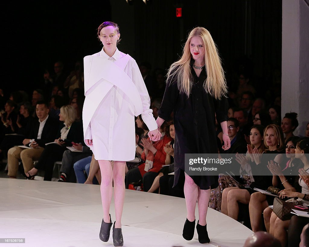 Designer Simone Kurland (r) walks the runway with a model wearing one of her designs at the 114th Annual Pratt Institute Fashion Show at Center 548 on April 25, 2013 in New York City.