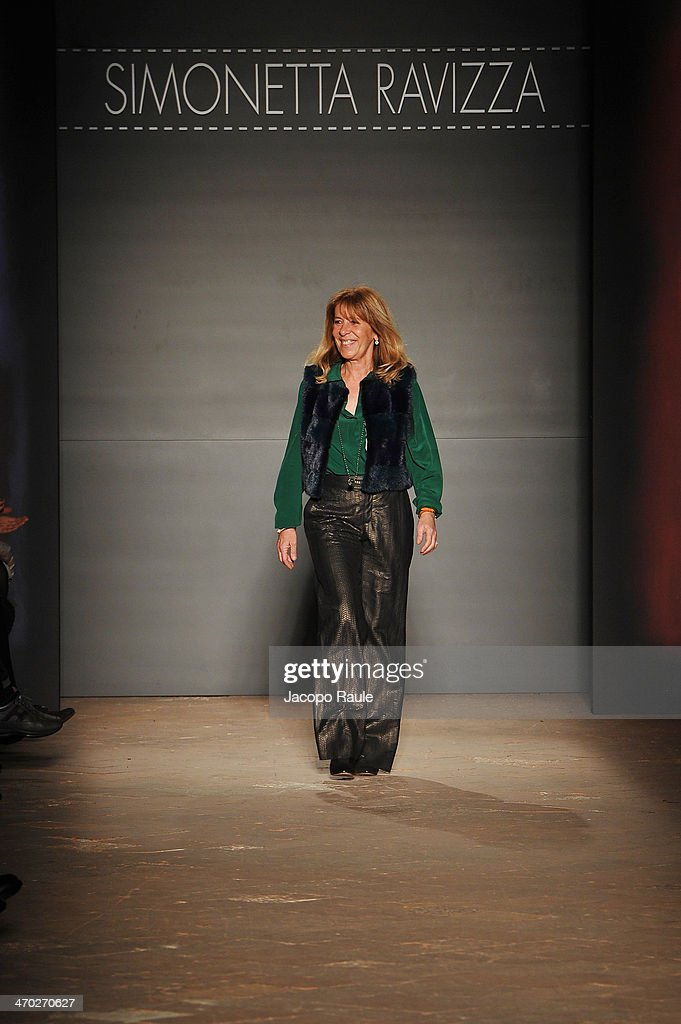 Designer <a gi-track='captionPersonalityLinkClicked' href=/galleries/search?phrase=Simonetta+Ravizza+-+Fashion+Designer&family=editorial&specificpeople=13981150 ng-click='$event.stopPropagation()'>Simonetta Ravizza</a> acknowledges the applause of the audience after the <a gi-track='captionPersonalityLinkClicked' href=/galleries/search?phrase=Simonetta+Ravizza+-+Fashion+Designer&family=editorial&specificpeople=13981150 ng-click='$event.stopPropagation()'>Simonetta Ravizza</a> show during Milan Fashion Week Womenswear Autumn/Winter 2014 on February 19, 2014 in Milan, Italy.