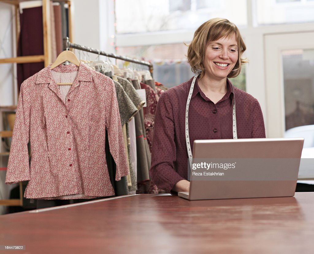 Designer smiles at email : Stock Photo